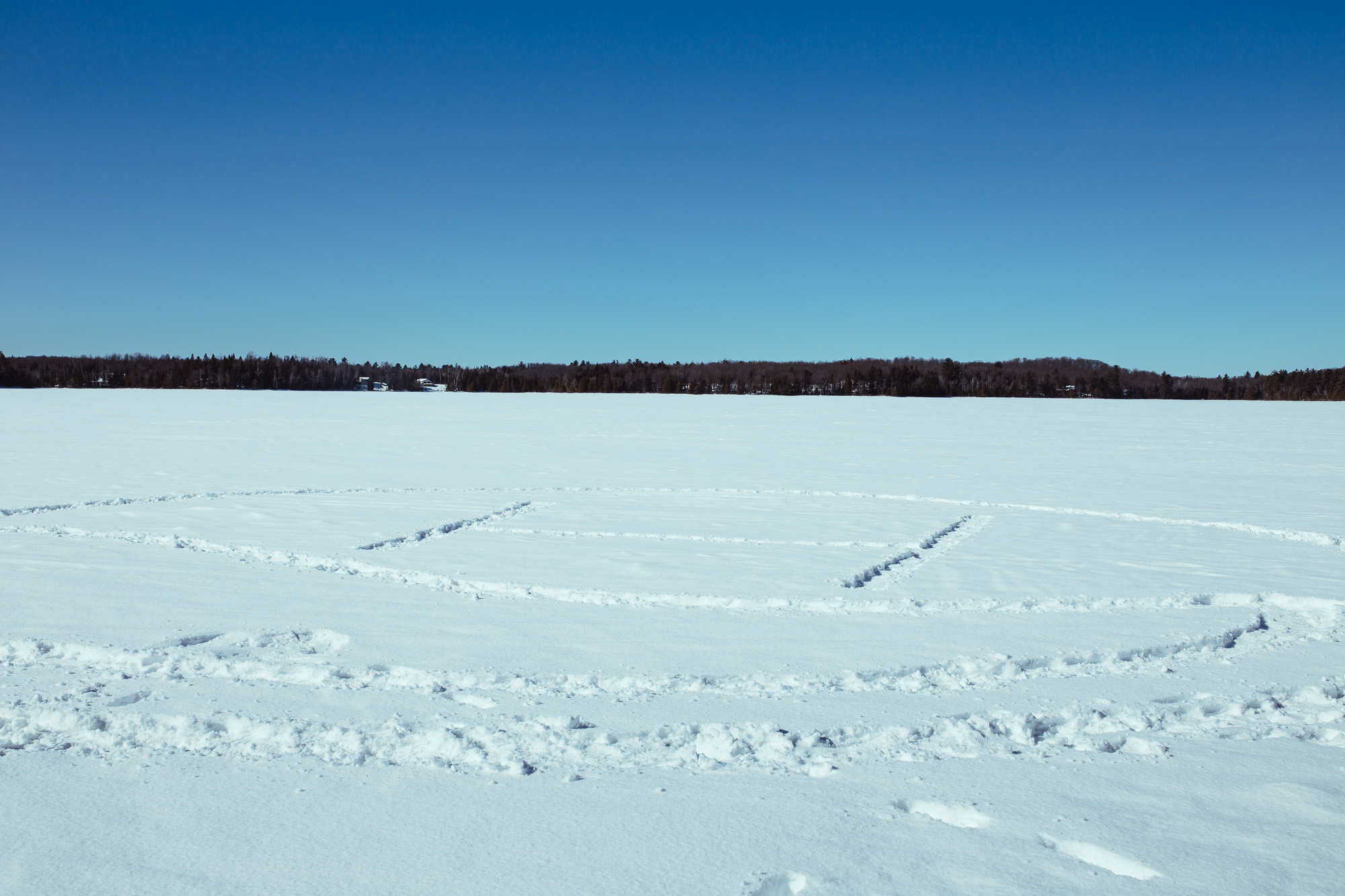 Drawing in snow on lake