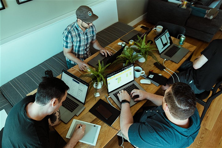 team working remotely from table together