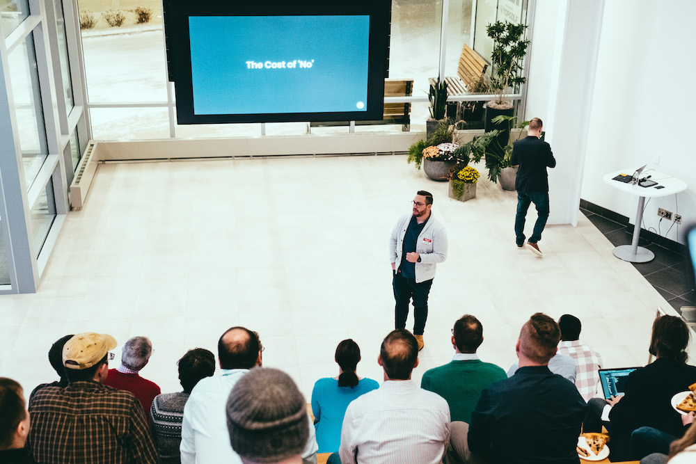 man giving presentation in front of audience
