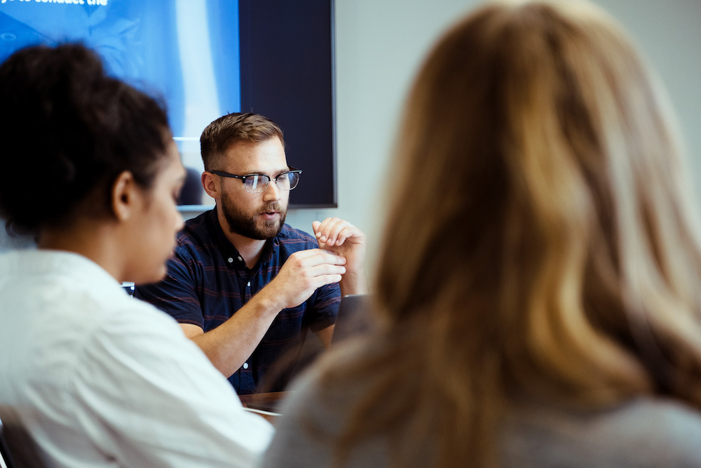 designer leading group discussion in conference room