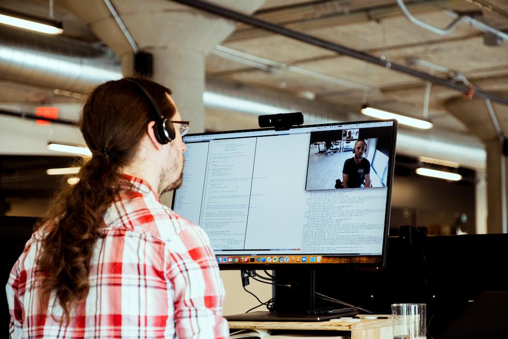 software developer pair programming at desk