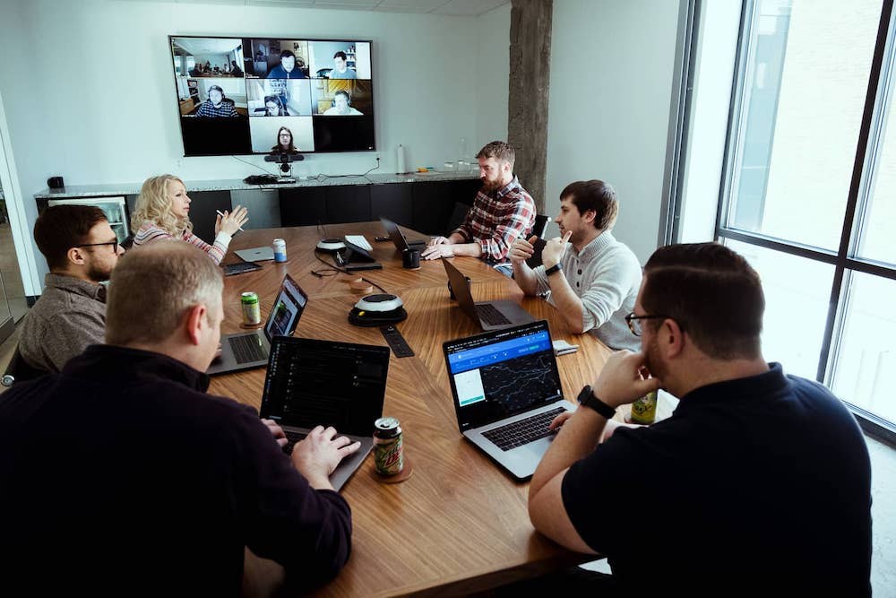 innovation team meeting with remote team on big screen