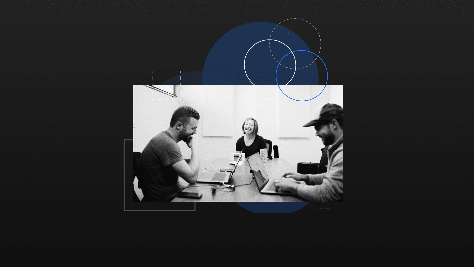 black and white photo of team meeting with client