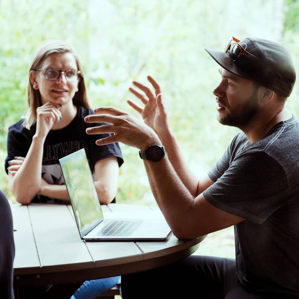 developers discussing projects at picnic table