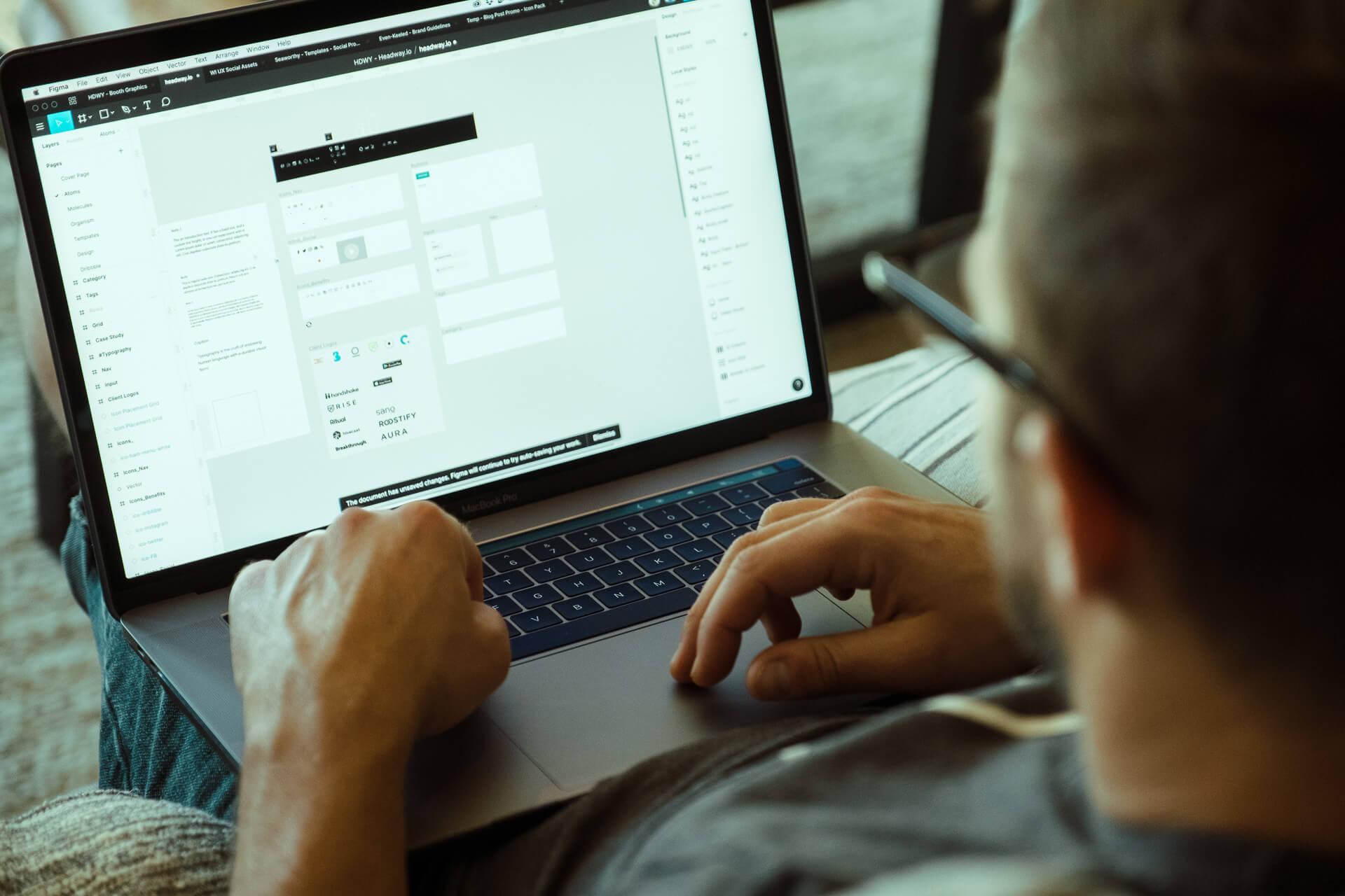 designer editing in figma on macbook