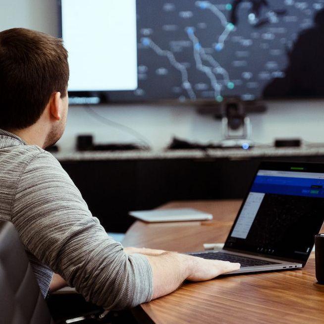 developer presenting demo in conference room