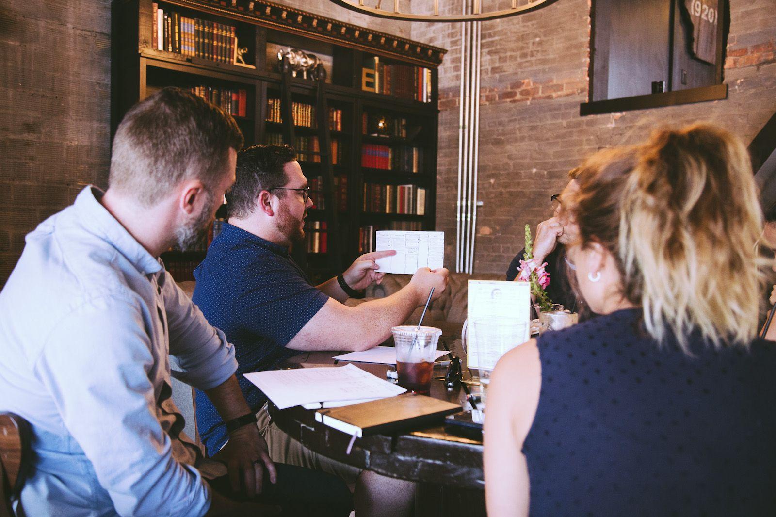 Design team presenting wireframes in coffee shop