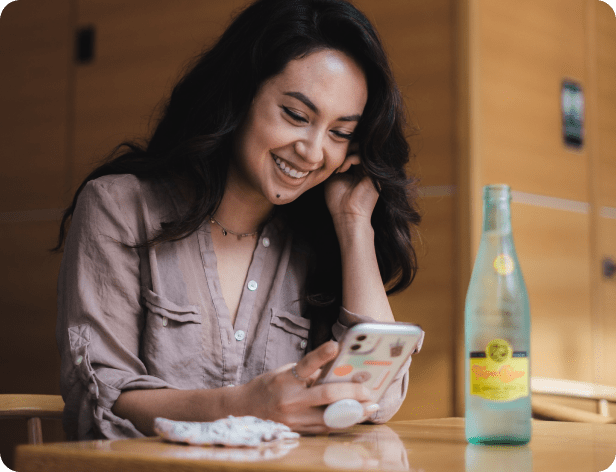 azimo client smiling while using mobile phone