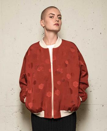woman wearing read varsity jacket