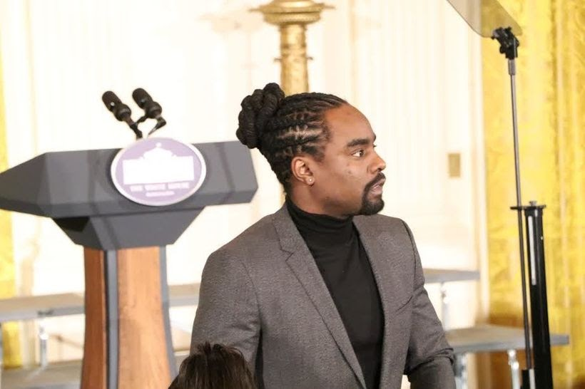 While waiting for Michelle Obama to bid her farewell remarks, Music Artist Wale was spotted standing in the front row of the