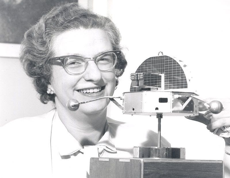 Nancy Roman with a model of the Orbiting Solar Observatory