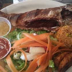 Bukom Red Snapper deep fried served with salad , plantains and rice