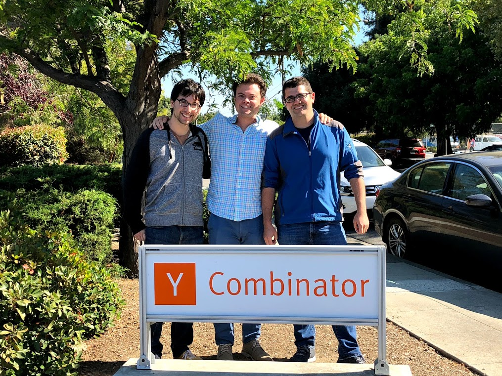 Modern Treasury Founders with the YC sign