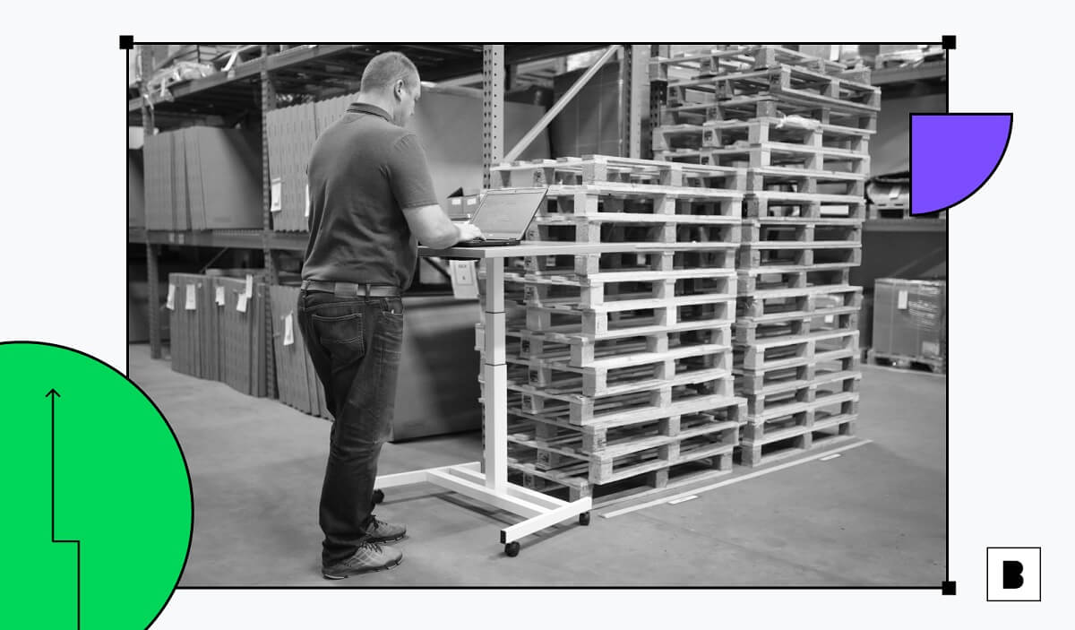 A man working in warehouse/backroom of a retail store