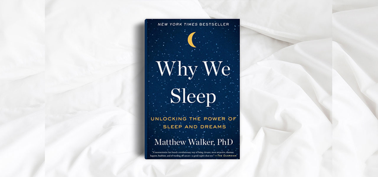 Why We Sleep book cover on white sheets.