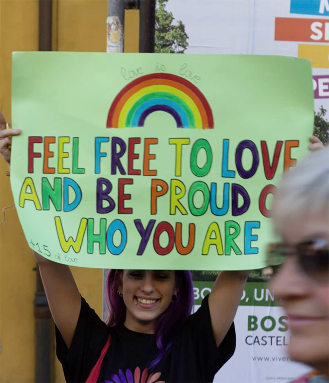 sign that reads feel free to love and be proud of who you are