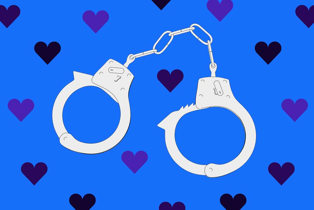 Handcuffs against a blue background with hearts.