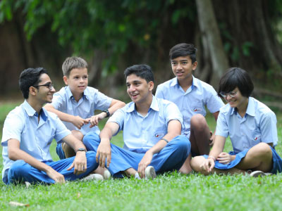 Secondary School Students being Happy while sitting in Open area of GIIS Tokyo Campus