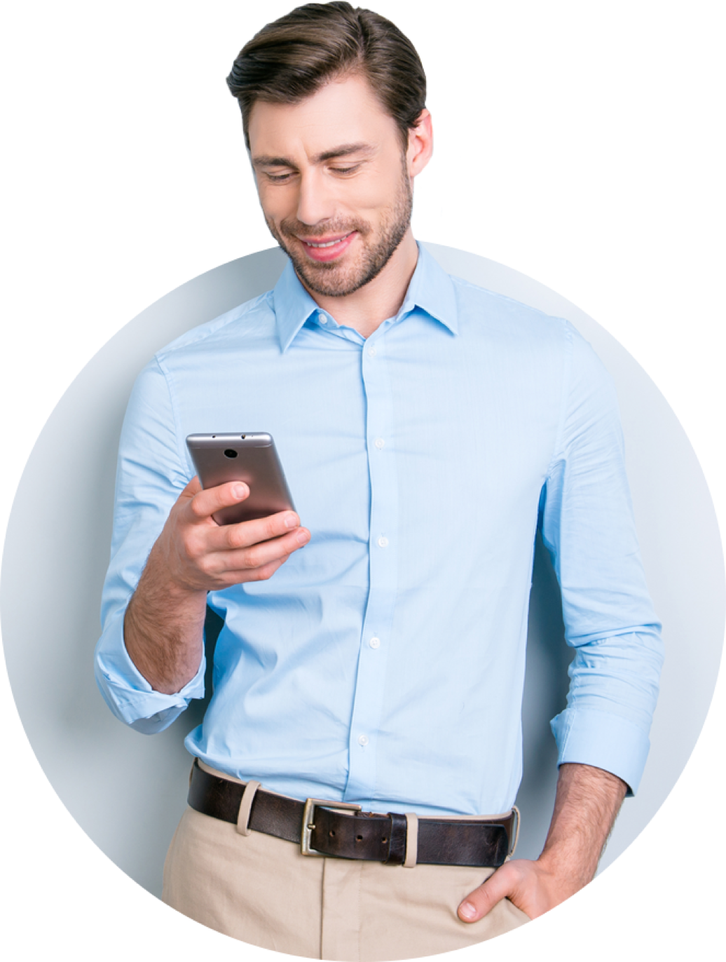 Man smiling at his phone dressed up