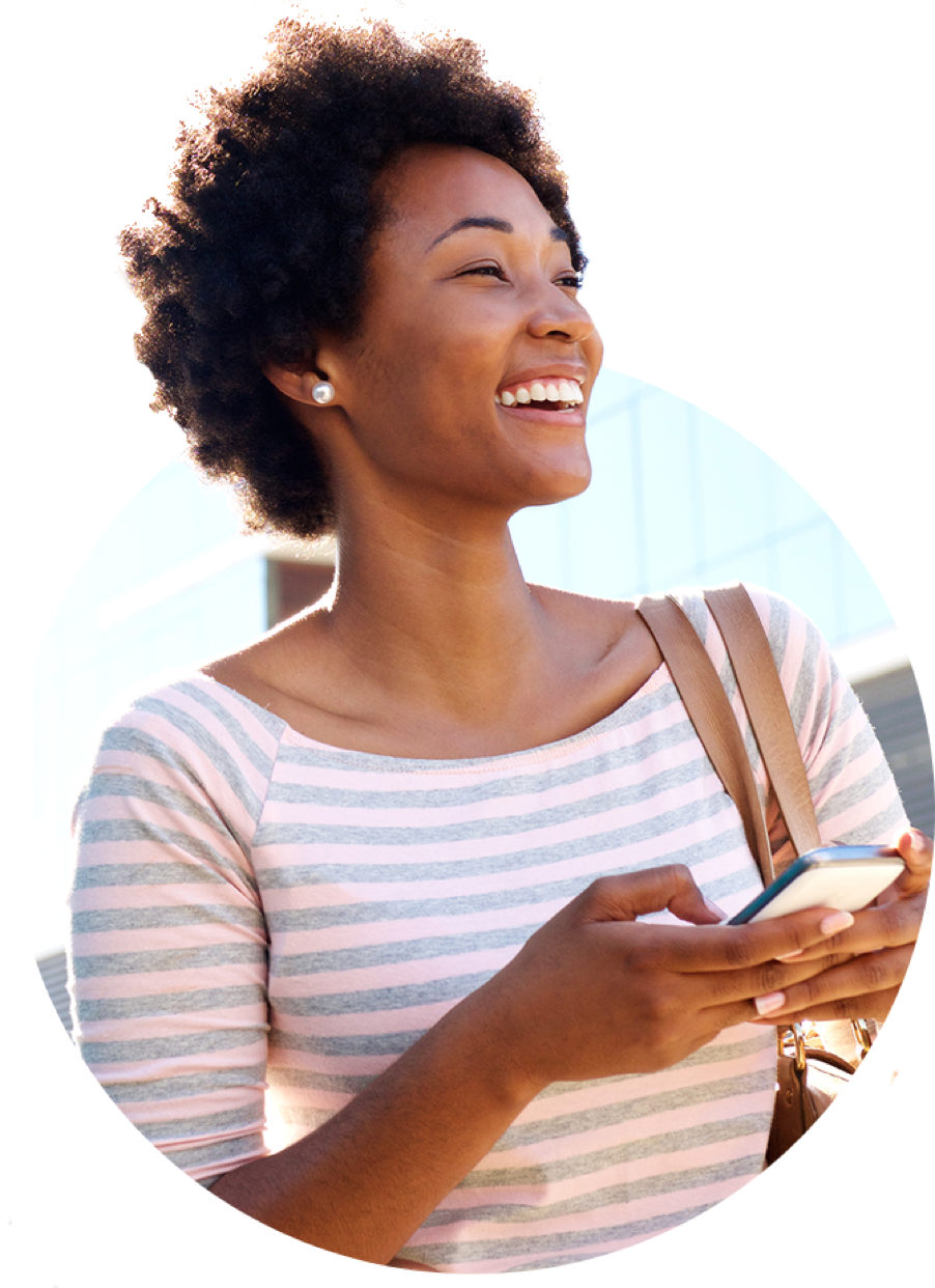 Smiling woman using Griddy app on her phone