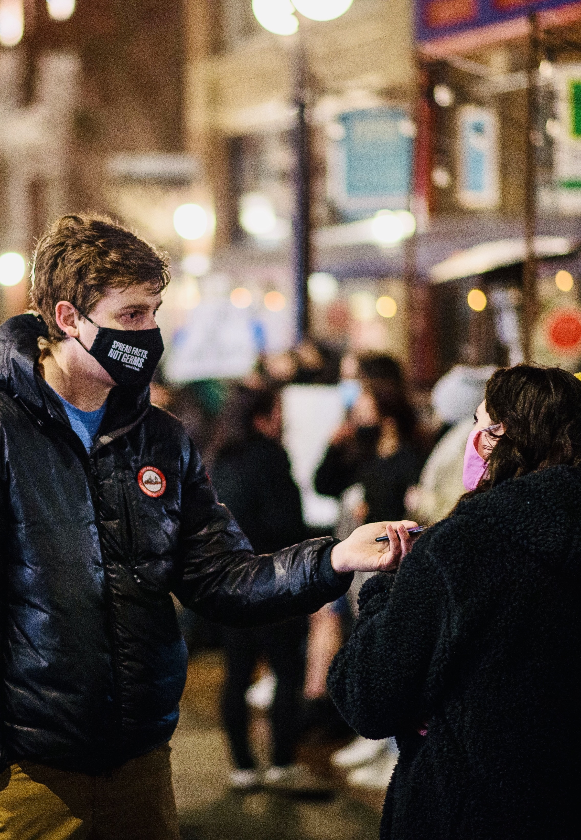 Capital Daily Editor Jimmy Thomson wears a mask while interviewing a person outside a protest at Chuck's Burger Bar in Victoria, BC.