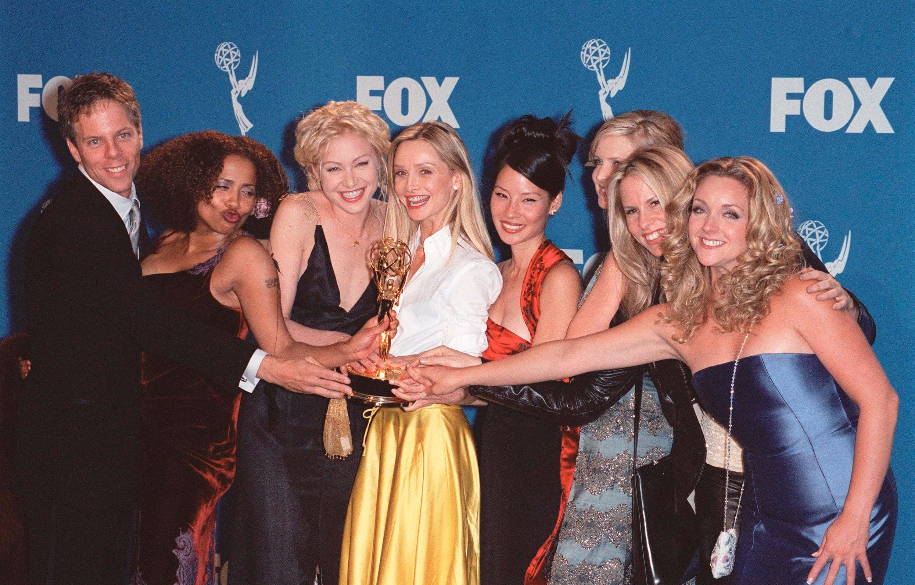 The Ally McBeal cast, including Calista Flockhart and Lucy Liu, at the 51st Annual Emmy Awards in Los Angeles where the show won the Best Comedy Series Award. Photo by Paul Smith / Featureflash.