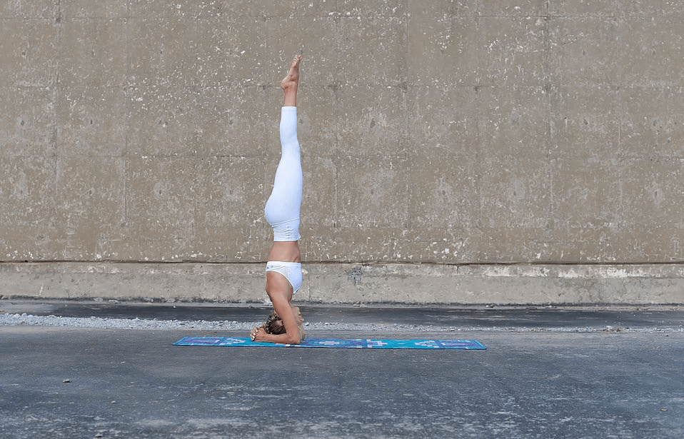 Straighten your legs and you're officially doing a headstand!