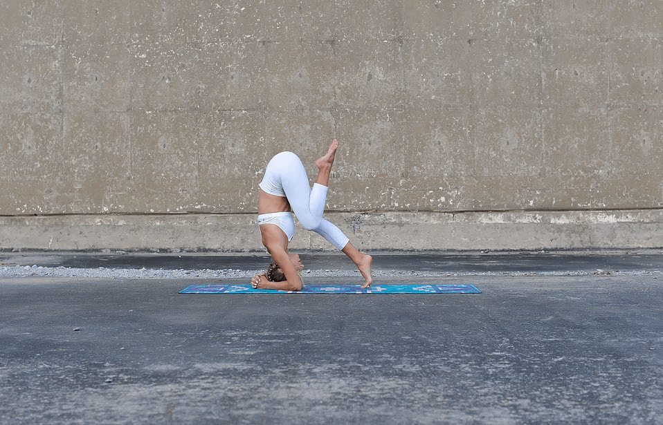 Bring in one knee for the next step of doing a headstand.