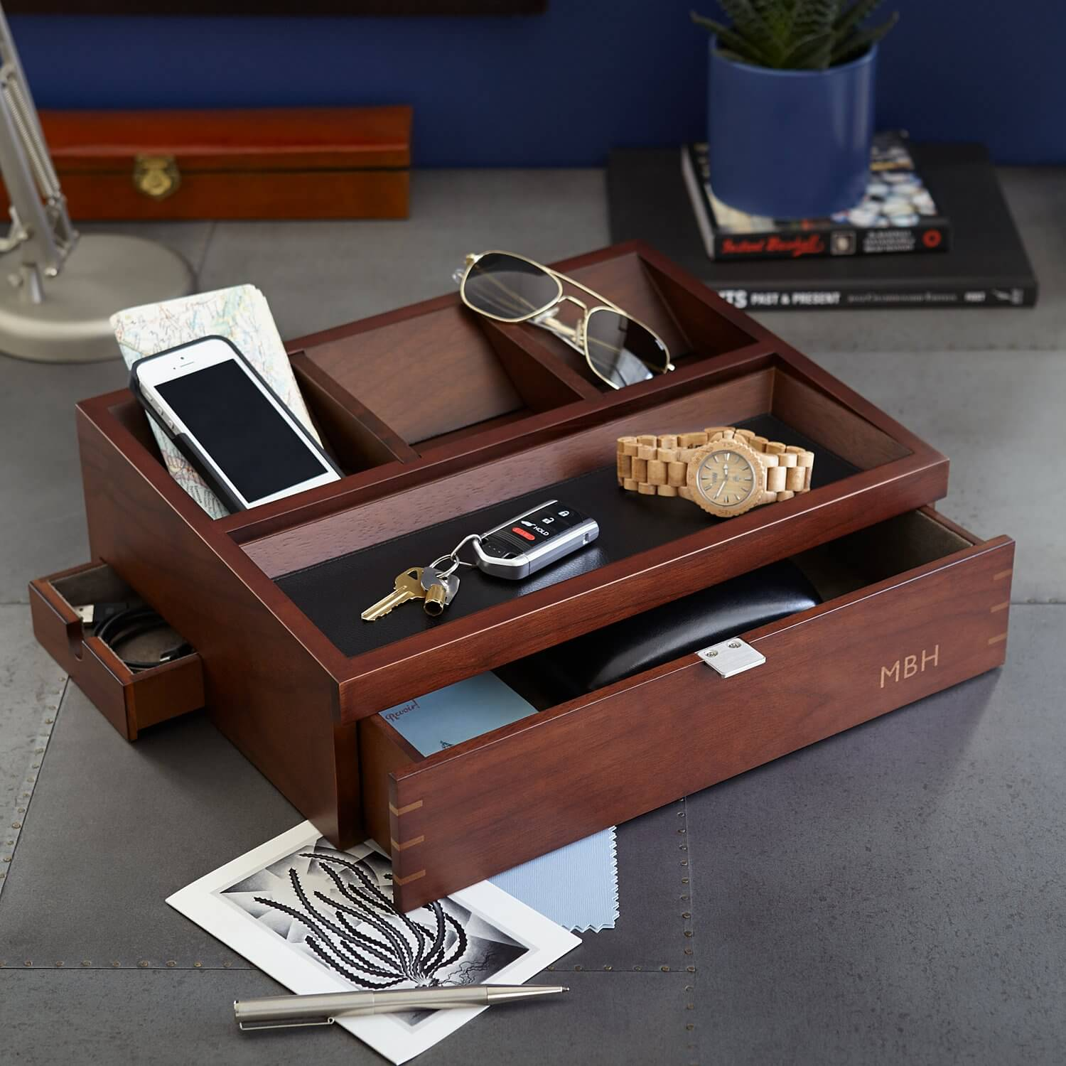 A wooden organizer and accessory charger.