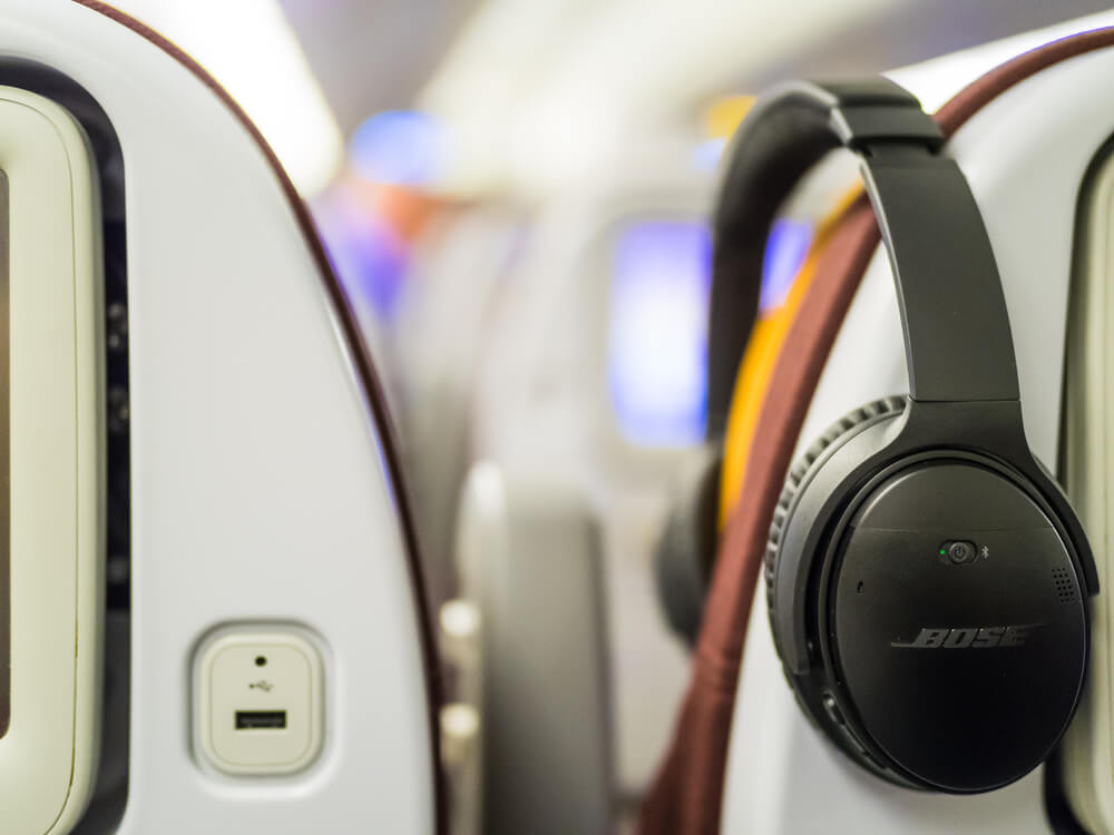 Noise cancelling headphones on a plane.