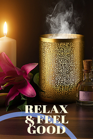 "A gold diffuser with the words ""Relax and Feel Good."""