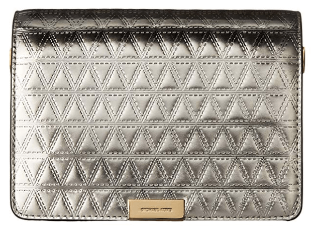 The Michael Kors Gusset Clutch in silver.