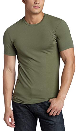 A man wearing a tight-fitting olive t-shirt from Calvin Klein.