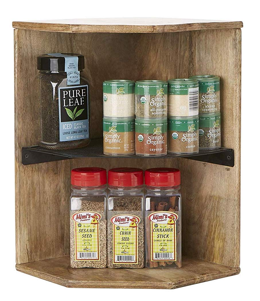 A wooden shelf designed to hold spices in the corner of a kitchen.