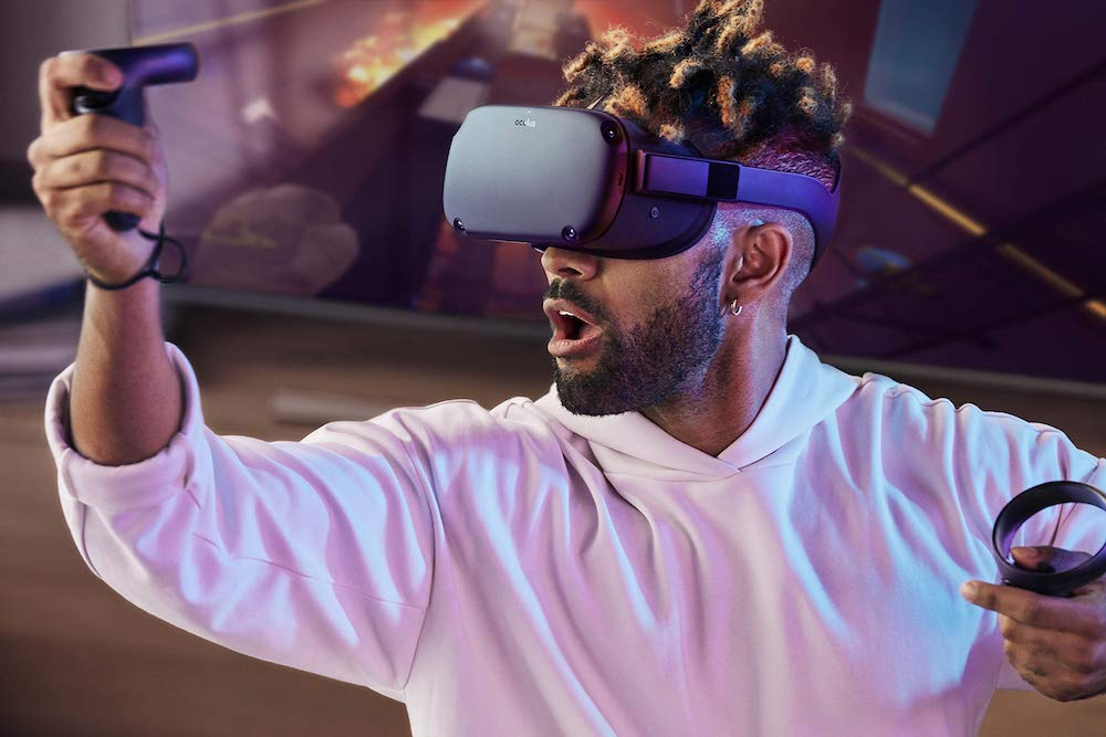 A person playing VR with the Oculus Quest.