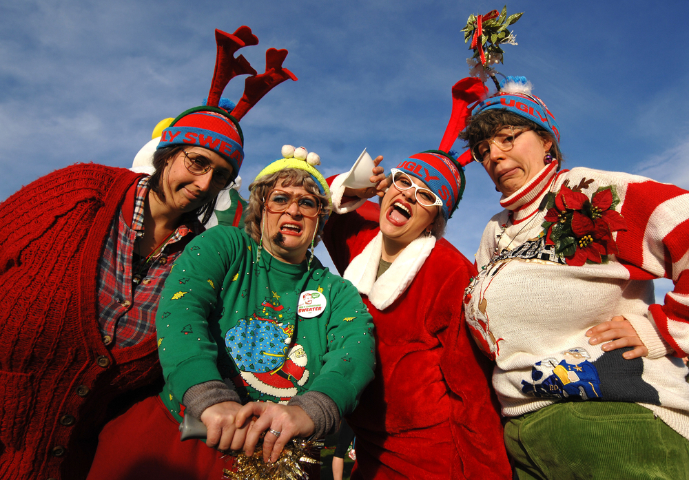 A group of people in Ugly Christmas sweaters.