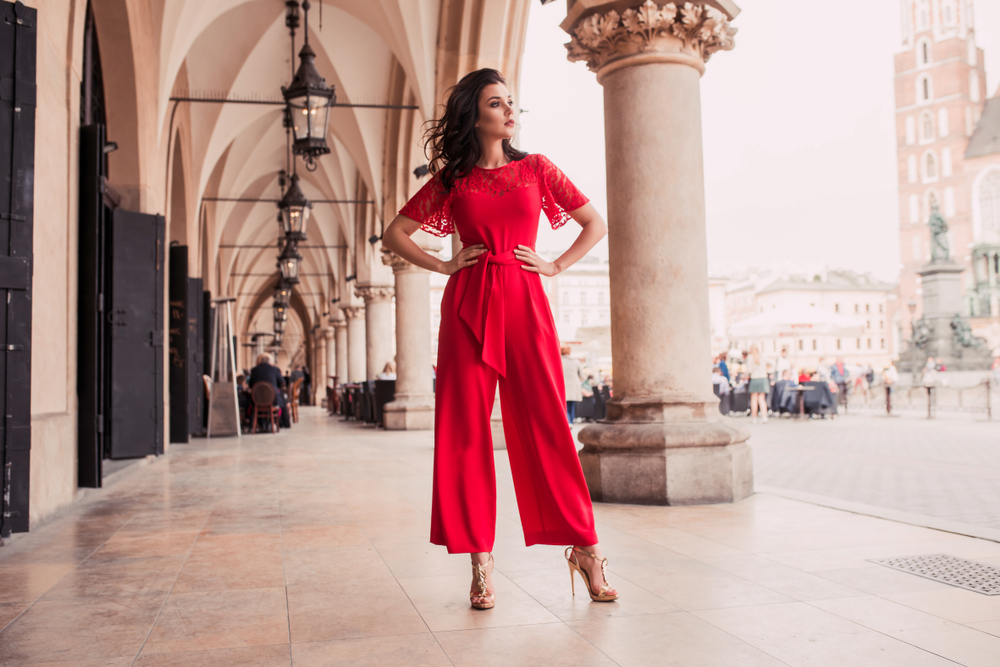 A woman in a red jumpsuit.