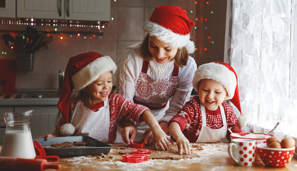 A family baking in Santa hats.
