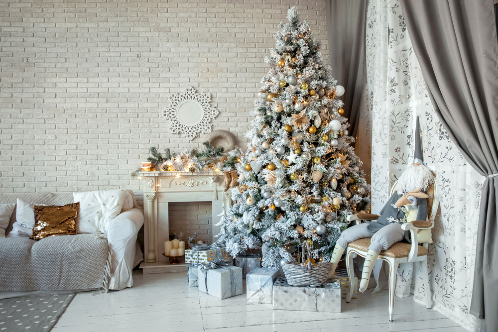 A living room with a white Christmas tree.