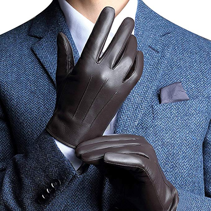 A man putting on nice leather driving gloves.