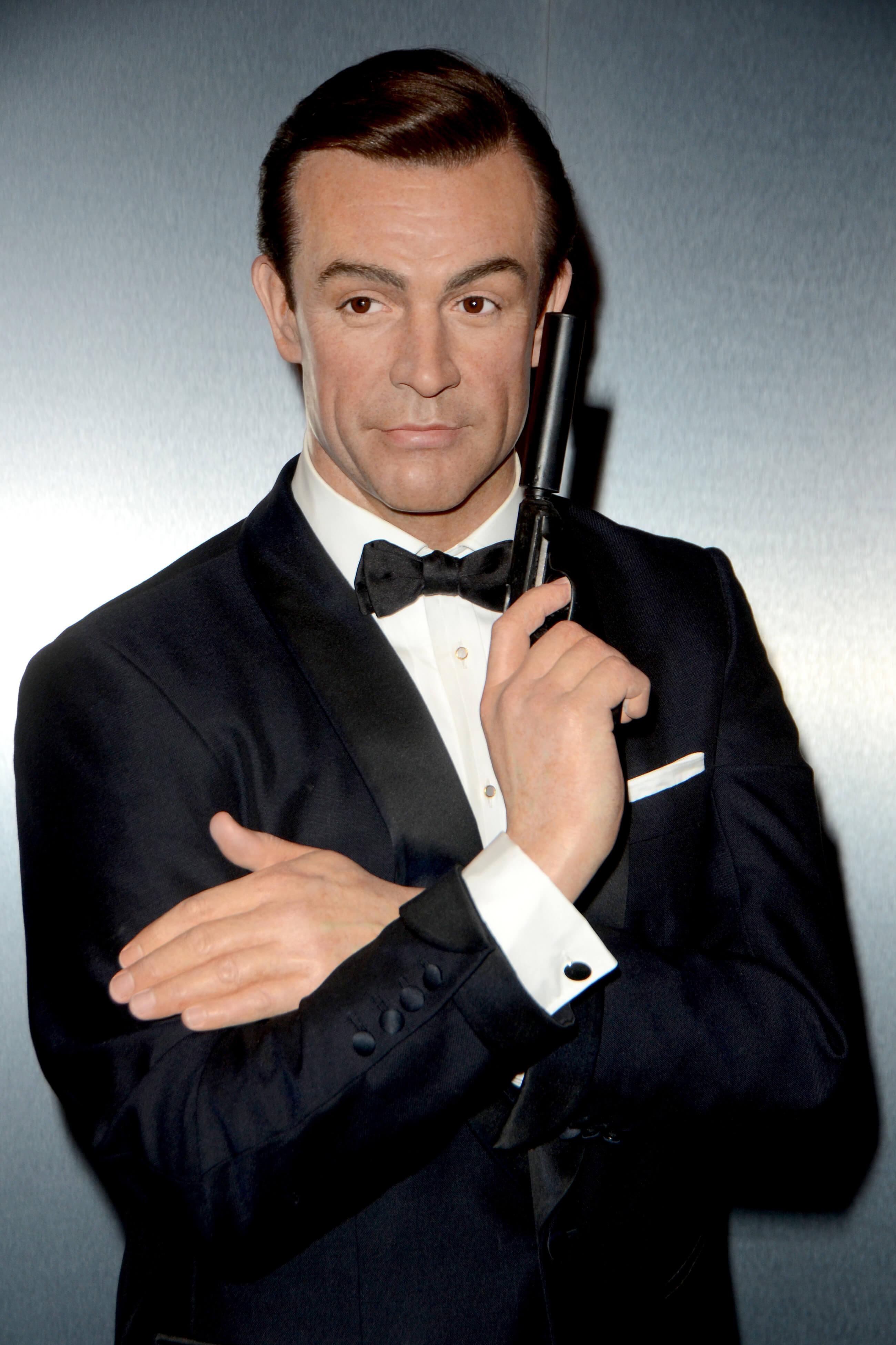 Sean Connery posing with a gun as James Bond in Dr. No 1962