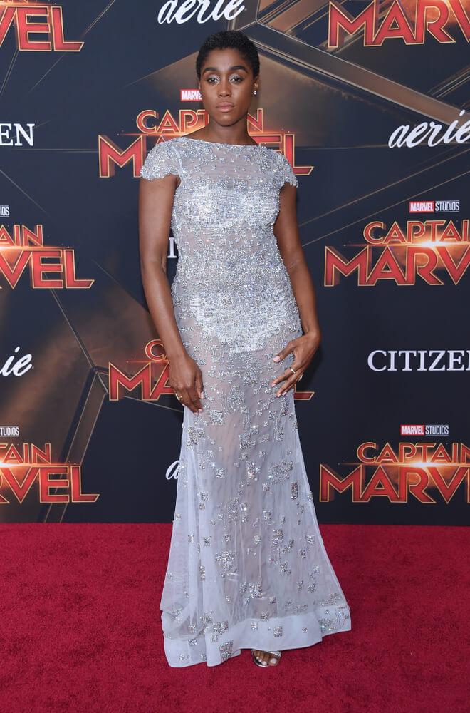Lashana Lynch at the red carpet premier for her new movie Captain Marvel in a silver dress
