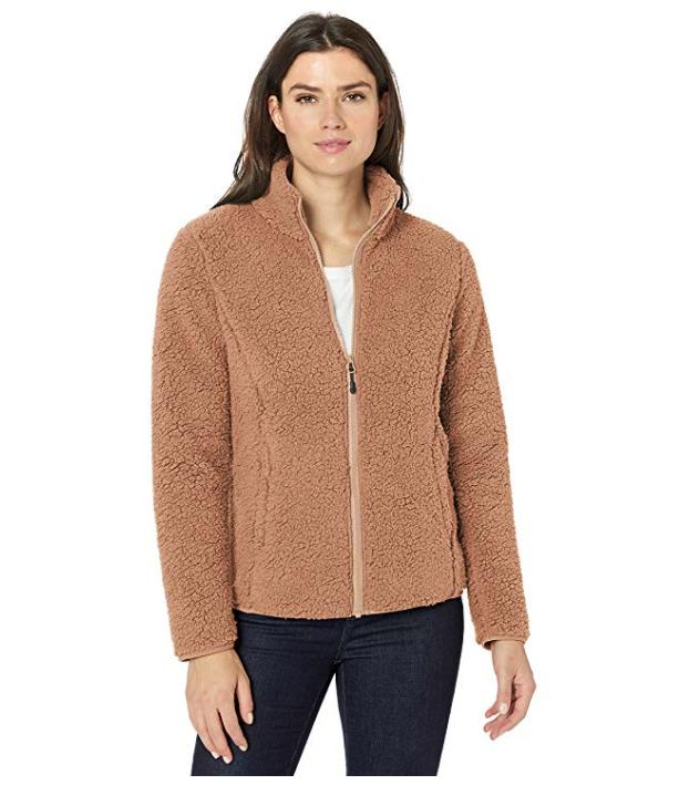 A woman wearing a fleece zipup.