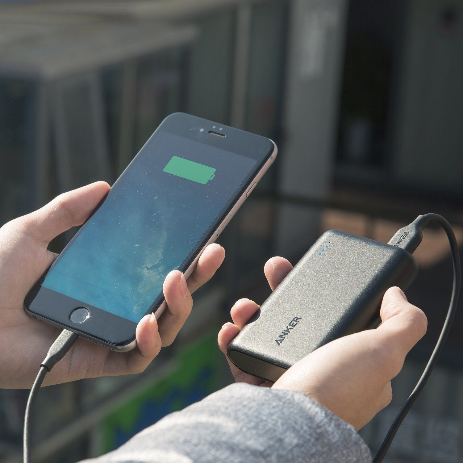 An iPhone plugged into an Anker charger.