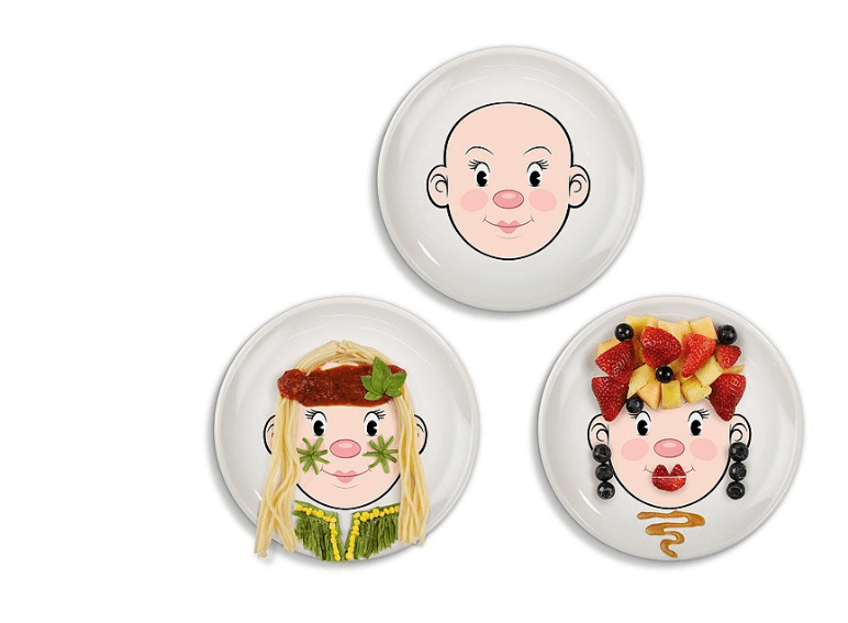 Three plates with faces on them so kids can play with their food.