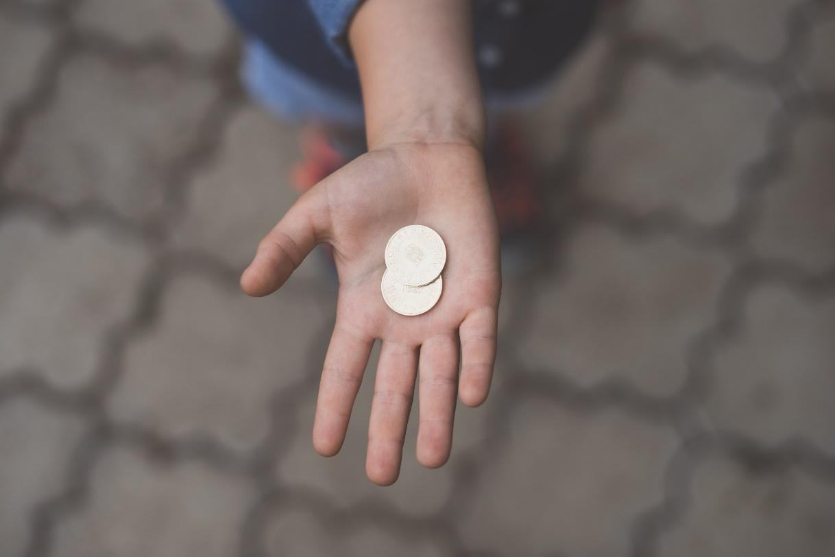 child with coin in hand
