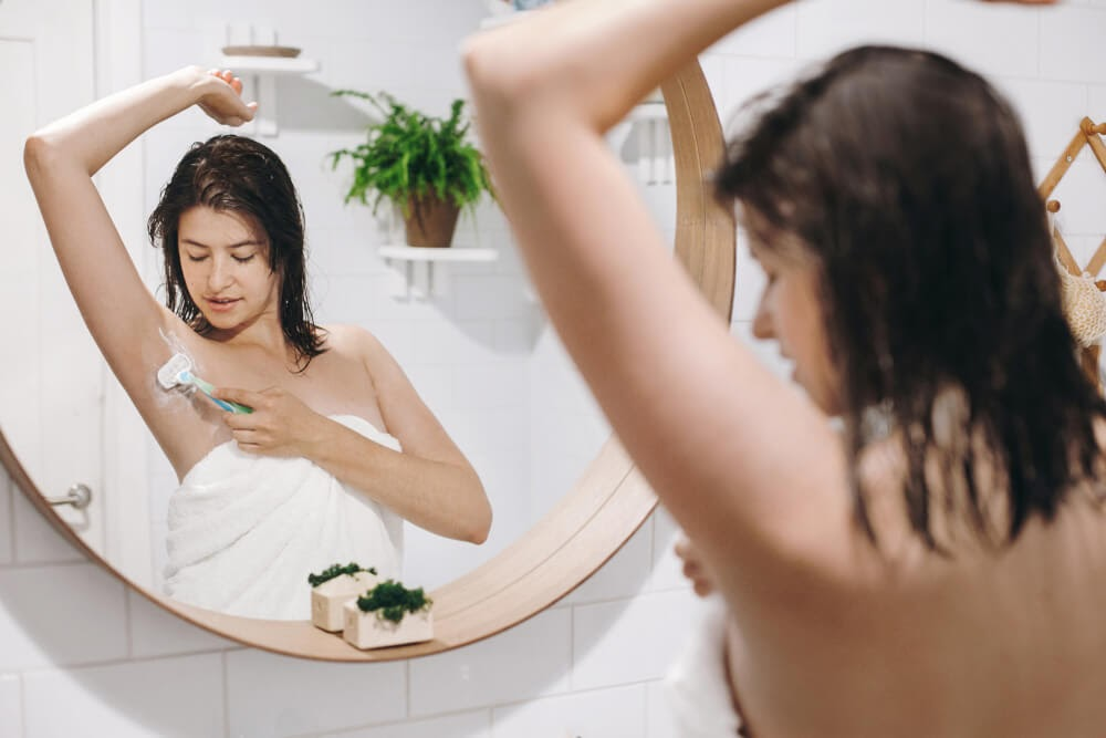 women shaving armpit