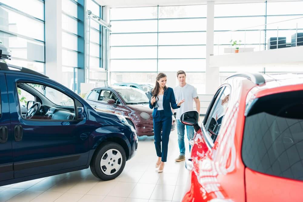 saleswomen at car dealership