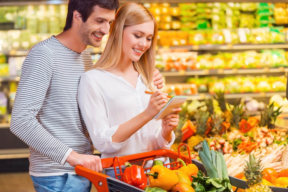 couple looking at grocery store list