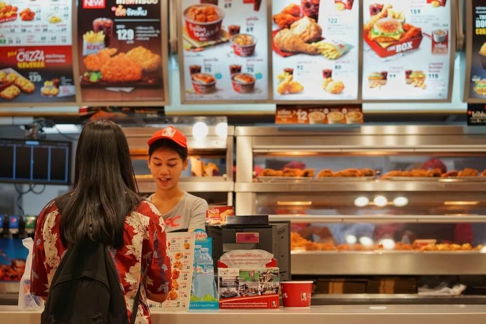 Woman at counter ordering KFC